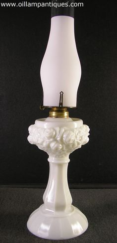 Antique floral embossed milk glass oil lamp with frosted chimney