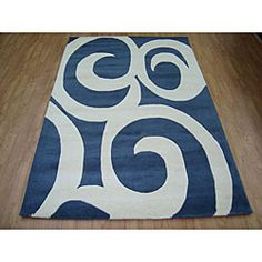 Blue Modern is a fine hand-tufted and hand-carved contemporary rugFloor rug is made from blended and hand-washed woolArea rug features white shapes on a blue background to accent your home decor