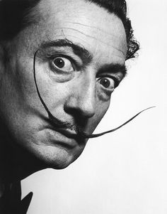 "Salvador Dali Dali was a Surrealist artist that produced a huge volume of works that spanned film, sculpture and paintings. He also worked with Hitchcock on a dream sequence for his film ""Spellbound"", which both the artist and the director hated. The artist's famous mustache is captured perfectly in this 1942 photo. Date: 1942. Photographer: Philippe Halsman."