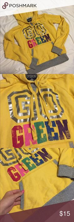 """Victoria's Secret PINK """"Go Green"""" Yellow Hoodie In great used condition! this has distressed letter writing on it with grey accents on the hoodie. It is very soft and in great shape for a new home! PINK Victoria's Secret Tops Sweatshirts & Hoodies"""