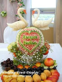 wedding fruit carving display with daikon swans