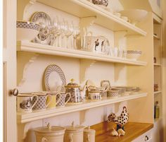 Open Shelves  - Don't forget to use ornate open shelves to display all those trinkets and storage vessels!
