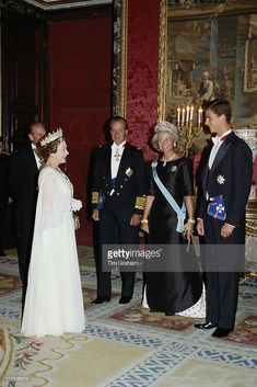 Queen Elizabeth II and Prince Philip meeting King Juan Carlos I of Spain, Queen Sofia of Spain and their son Felipe, Prince of Asturias, at the Palacio Real de Madrid, in Madrid, for a state banquet in Spain, 18 October 1988.