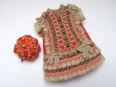Tiny all bisque doll dress and hat