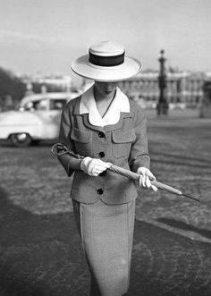 Model wearing a suit by Jean Patou in a photo by Georges Dambier ~ Paris ~ 1957.