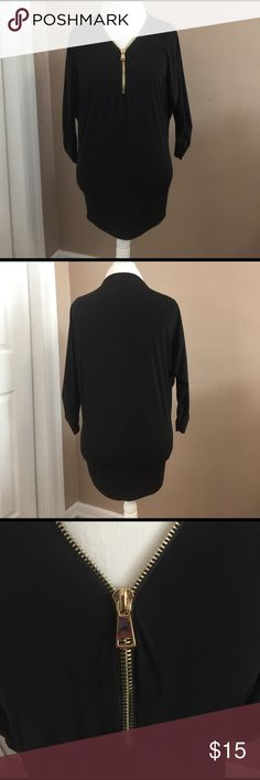 """Suzy Shier Zip Front Tunic Black tunic length with gold tone zipper down chest front and front of neckline. 3/4 length sleeves with side ruching . Blousy effect with a looser upper portion over a more fitted lower . 27"""" shoulder to bottom. 23"""" armpit to armpit. 96% polyester 4% spandex. Suzy Shier Tops Tunics"""