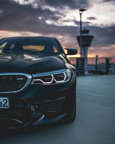 The excitement starts at sundown. The BMW Sedan in BMW Individual Azurite Black metallic. Fuel consumption (combined): km; emissions (combined): g/km Bmw M5, M Bmw, Bmw Z4 Roadster, Luxury Car Brands, Luxury Cars, Ford Gt, Triumph Bonneville, Street Tracker, Audi Tt