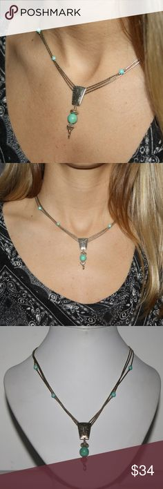 Sterling silver and Turquoise Adjustable necklace Adjustable from 20-26 inches stunning sterling silver necklace. liquid silver. * there is a ring at the bottom of pendant to add to a charm. Buy from me with confidence! I have sold over 900 items with a 5 star rating! See multiple items you can't live without? Add them to a bundle to receive a private offer of Buy one Get one Free!  No limits! *lesser items will be free*  Comment done and i'll send you the offer! sterling Jewelry Necklaces
