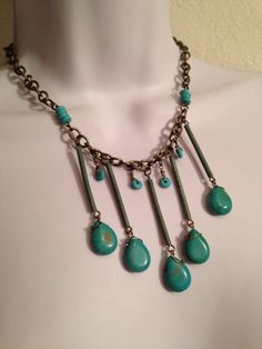 A personal favorite from my Etsy shop https://www.etsy.com/listing/238387356/bronze-and-turquose-statement-necklace