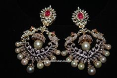 Brilliantly designed large diamond chand bali earrings with peacock design and a small jhumki drop in the middle of the balis. Diamond Jhumkas, Gold Jhumka Earrings, Gold Diamond Earrings, Gold Earrings Designs, Diamond Studs, Diamond Jewelry, Drop Earrings, Gold Designs, Big Earrings