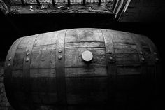 TITLE: Aging Wild Turkey 101 Bourbon Whiskey Barrel #1  ABOUT Wild Turkey is a brand of Kentucky straight bourbon whiskey distilled and bottled by the Austin Nichols division of Campari Group. The distillery is located near Lawrenceburg, Kentucky.  This photograph was taken sometimes in summer of 2015, while visiting the Wild Turkey distillery for a scheduled photo shoot. The main warehouse is stacked with rows of bourbon barrels that was at different aging stages. I wish I could convey the…