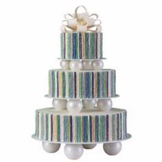 This towering beauty makes an unexpected splash. Roll fondant into logs similar in diameter to a pencil. Set the stripes to shimmering with White Cake Sparkles before attaching to cakes.