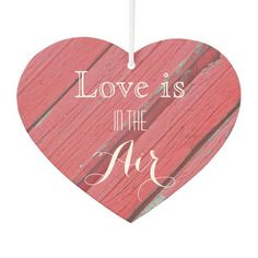Personalize the charming heart shaped Love is in the Air Rustic Red Barn Wood Wedding Air Freshener with the names of the bride and groom and marriage ceremony date. Create customized wedding favors, save the date announcements or keepsake gift. This shabby chic custom country wedding air freshener features a photograph of red barn wood. Perfect for your casual yet classy rural country farm, rustic barn or ranch wedding theme. #barnwedding #rusticwedding #partyfavors #weddingfavors