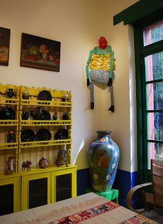 Burning blue - Frida Kahlo's La Casa Azul in Coyoacan |  One of the smaller rooms, like a corridor between a bed room and the kitchen. A so called 'Judas figure', a skeleton reminding of Judas who betrayed Jesus, hangs in the corner; several of them were around the house and gardens.