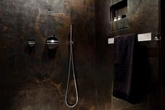 Inside the Shower of the Luxury Yacht by Art of Kinetik...love the stone walls!