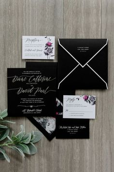 Custom silver foil wedding invitation with a black and white floral liner and Swarovski crystal embellishments.