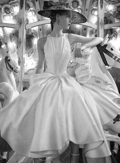 Unknown model or designer but it's a perfect dress for a rehearsal dinner or low key engagement/wedding dress!