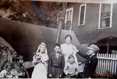 """My mother's first """"wedding"""". My uncle is at the far right, and my grandmother is in the back. Taken in the Brighton Park neighborhood of Chicago, about 1942. Their father was a minister, can you tell?"""