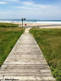 A wooden ramp leaves you on the beach of La Vega in Ribadesella, Asturias, northern Spain. Follow it!