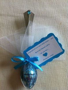 A spoonful of Hershey Kisses.  See more bridal shower favor ideas at www.one-stop-party-ideas.com