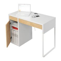 MICKE Desk IKEA Cable outlets and compartment in the back keep your cords and cables out of view but close at hand.