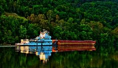 We Move Coal... A tugboat with a single empty barge heads for a coal loader on the Kanawha River