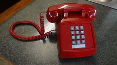 The Red Phone! I love it!  This is an excellent phone in great condition. It has some very minor markings that are hardly even noticeable. In the old comics and movies,