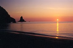 Sunset on Agios Gordios beach in Corfu, Greece