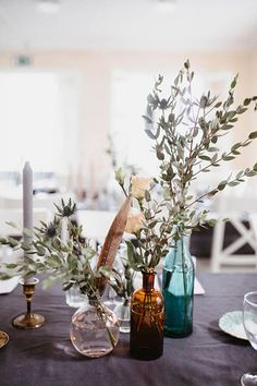 Trendy Bohemian Wedding Decorations ★ bohemian wedding decorations centerpiece with greenery branch feathers and glass vases and bottles patrick karkkolainen wedding centerpieces diy Trendy Bohemian Wedding Decorations Decoration Branches, Greenery Centerpiece, Wedding Table Centerpieces, Centerpiece Ideas, Wedding Tables, Wedding Reception, Simple Table Decorations, Wedding Bride, Bridal Shower Table Decorations