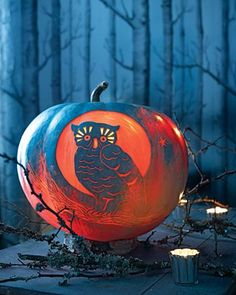 love this painted carved pumpkin!
