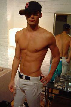 A man in baseball pants....