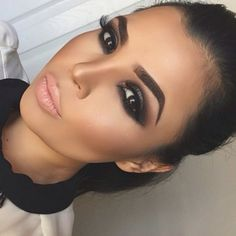 Dark smokey eyes and neutral lip color.