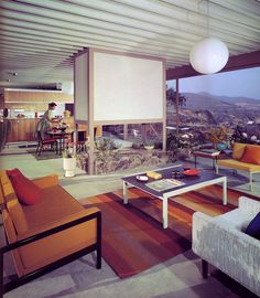 The perfect early 60s housewife, in her perfect midcentury home.  Pierre Koenig, Case Study House #22, 1960. via
