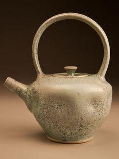 Ben Owen altered Japanese-style teapot in patina green glaze.