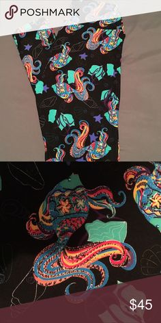 LuLaRoe hard to find print Betta Fish! Gorgeous! LuLaRoe hard to find unicorn print of Betta Fish with sea shells and bubbles! Gorgeous bright vibrant colors on a black background! OS brand new with tags! LuLaRoe Pants Leggings