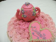 A Tea Party cake. Yes, you can eat the tea pot! Made at 3 Women and an Oven in Overland Park, KS  http://3womendesserts.com/