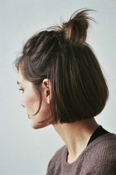 Half-up anything is the definition of effortless glam—simply tie the very top half of your bob into a messy bun and leave a few strands down to frame your face. #shorthairstylesbob