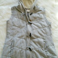 """SALE Roxy Quilted Gray Vest with Fur Hood Adorable Roxy Quilted Gray Vest with Fur lined Hood and Pockets.  25"""" from top of shoulder to bottom 20"""" from armpit to armpit Roxy Jackets & Coats Vests"""
