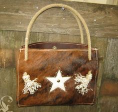 Hair on Cowhide purse with recycled Lariat ropes. $110