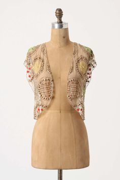Light Posy Shrug from anthropologie  £98.00  ck very beautiful for going over black or dark brown dresses I have