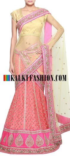 Get this beautiful lehenga here: http://www.kalkifashion.com/orange-lehenga-adorn-in-kundan-embroidery-only-on-kalki.html Free shipping worldwide.