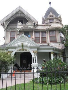 The 1894 Frederick Mitchell Mooers House in Los Angeles.  Some really good attempts at highlighting architectural details with paint.  Nice tower and entry but what I really love is the swooping opening to the 3rd floor balcony!