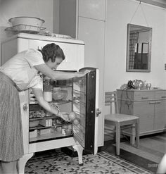 "There's something familiar about that linoleum floor.  May 1942. ""Greenbelt, Maryland. Federal housing project. Mrs. Leslie Atkins taking an orange out of her well-stocked refrigerator."" Medium-format negative by Marjory Collins for the Office of War Information."