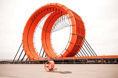 Giant Hot Wheels Track With Double Vertical Loop and Real Race Car Drivers? Check. | The real double loop track next to it's toy version.  | Credit:Photo: Lindsey Boice, courtesy Mattel | From WIRED.com