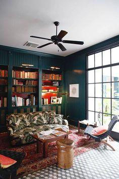 Dark walls, orange behind books