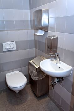 Fully Tiled Single Public Restroom With Wall Mounted Amenities