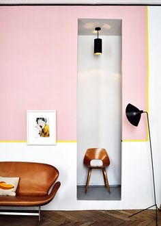 Living space with  a citrus yellow accent line and retro-inspired furniture