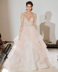 "Hayley Paige unveiled her new wedding dresses during Bridal Fashion Week. Here, see the Spring 2017 collection. ""Lorelai"" Rosewater long sleeve ball gown, floral beaded and embroidered illusion bodice, cascading tulle skirt."