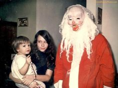 """wow... just no!!! LMAO... Looks like someone dragged in road-kill, slapped a red suit on it, propped it up, rounded up 2 kids & a camera, and yelled """"...and to all a nightmare tonight""""."""