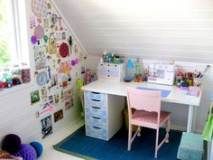 Love this sewing area...and the inspiration wall....very creative!